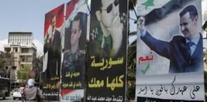 Portraits des candidats à la présidentielle, Damas, le 2 juin 2014 - REUTERS/Khaled al-Hariri