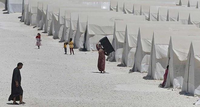 Depuis conflit 2011, 11 millions Syriens déplacés 3,8 millions fui pays. La Turquie aujourd'hui principale destination 1,59 million réfugiés (photo: camp Suruc)