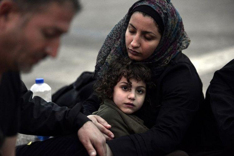 Une Syrienne et sa fille, à leur arrivée à Lesbos, en Grèce, le 18 juin.
