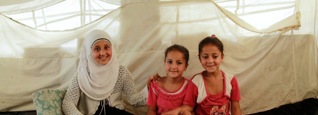 Umm Abdu's daughters, Siham, Hala and Nur in the Old Garage camp in Syrian government-controlled Tartus. (Ghenwa Yusuf/Good Morning Syria)