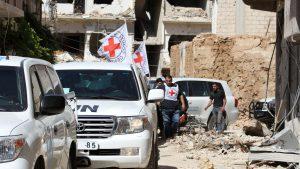 un-convoi-d-aide-humanitaire-a-son-arrivee-le-1er-juin-2016-a-daraya_5613357