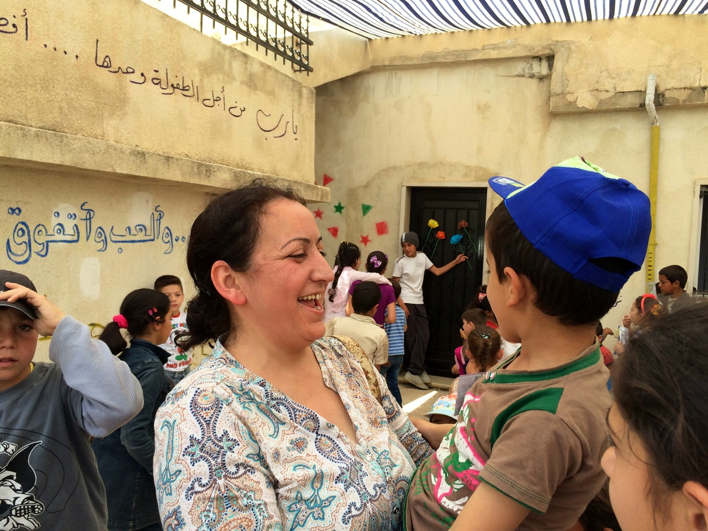 Ola Al-Junde, 43, is a Syrian math teacher who juggles her day job managing one school for Syrian refugee kids with volunteering at others. (Annia Ciezadlo)
