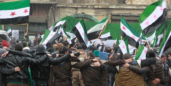 من مظاهرات الذكرى الخامسة لانطلاق الثورة السورية في حلب (عبد الرحمن اسماعيل/ رويترز).