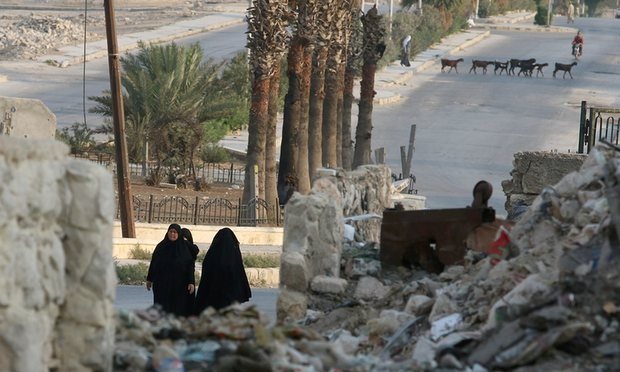 Women walk through the rubble of a neighbourhood in Aleppo, Syria, 30 August 2016. Photograph: Abdalrhman Ismail/Reuters