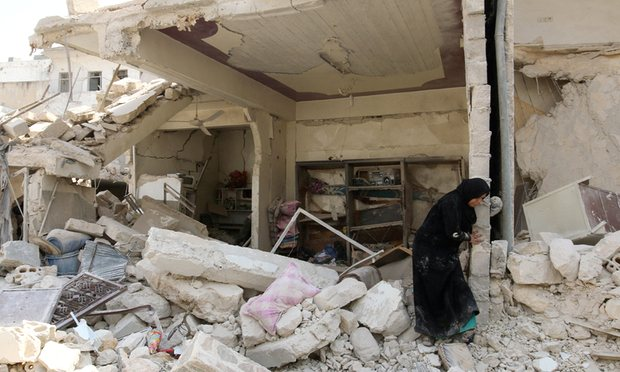 A woman inspects the damage after an airstrike in the Bab al-Nairab neighborhood of Aleppo, Syria, August 2016. Photograph: Abdalrhman Ismail/Reuters