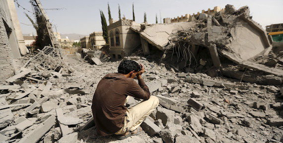 A guard sits on the rubble of the house of Brigadier Fouad al-Emad, an army commander loyal to the Houthis, after air strikes destroyed it in Sanaa, Yemen June 15, 2015. (Reuters/Khaled Abdullah)