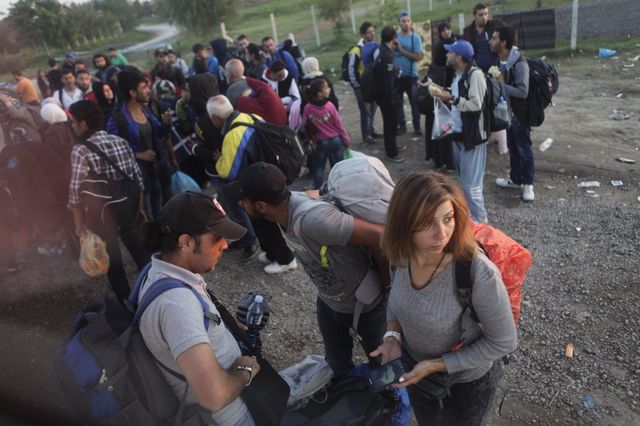 Luna Watfa (foreground, holding a phone) on her long journey to Germany after fleeing Syria. Following 63 days in detention, Watfa was rejected by members of her family. Fearing she would be arrested again, she crossed the border to Turkey with the help of a network of media activists. (Harry Shun)