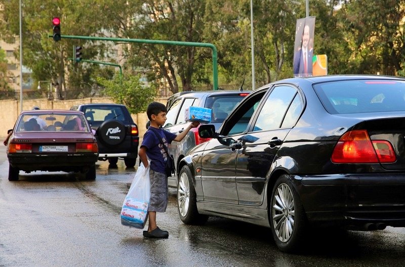 A Syrian child sells tissues for drivers in Beirut, Lebanon, May 28, 2016. (AP/Bilal Hussein)